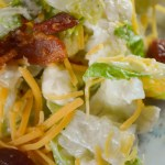 Topped with bacon and cheese and flavored with a ranch dressing mix, this Ranch Cauliflower Salad is a great side dish any night of the week.