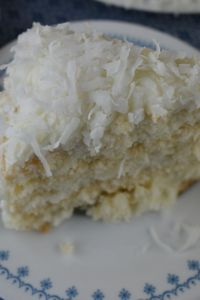 Three Day Coconut Cake with sour cream uses a boxed cake mix and just three other ingredients to make a delicious dessert for the coconut lovers in your life.  Using fresh frozen coconut, this 3 day coconut cake is special.