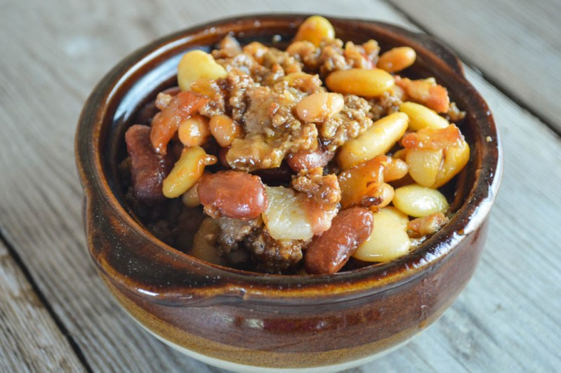 These Crock Pot Calico Beans are easy to make and full of flavor. With bacon, ground beef and four kinds of beans, it is a hearty side dish.