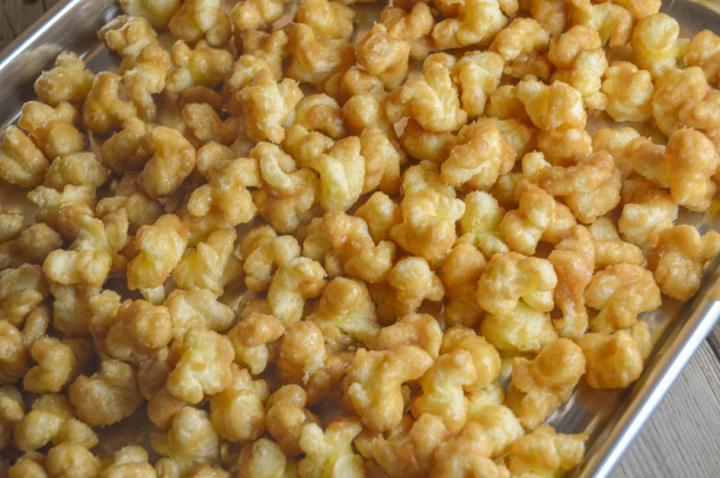 Caramel Puff Corn takes an ordinary snack food and turns into a sweet treat that you won't be able to stop yourself from eating!