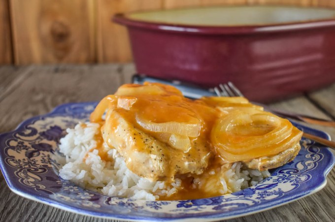 These Fancy Baked Pork Chops in a Deep Covered Baker are delicious and perfect over rice.