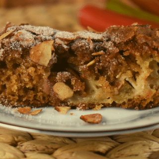 Old Fashioned Rhubarb Coffee Cake Recipe features a homemade cake filled with delicious rhubarb and a crunchy cinnamon sugar topping.  This will quickly become one of your favorite coffee cake recipes.