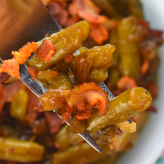 Sweet and Sour Green Beans with bacon is a fast way to jazz up a regular can of green beans. Bacon, onions, sugar and vinegar turns a bland can of beans into a family-pleasing side dish in no time flat.
