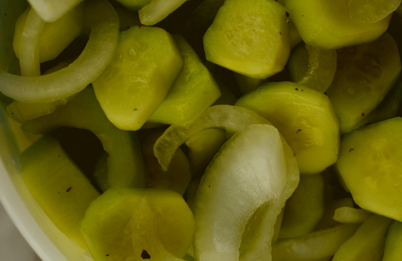 Mom's Cucumber and Onions is an old fashioned recipe featuring simple garden vegetables.  The ingredients are simple--cucumbers, onions, salt, vinegar, sugar, celery seed and black pepper, but the finished result is the perfect accompaniment to any summer meal.