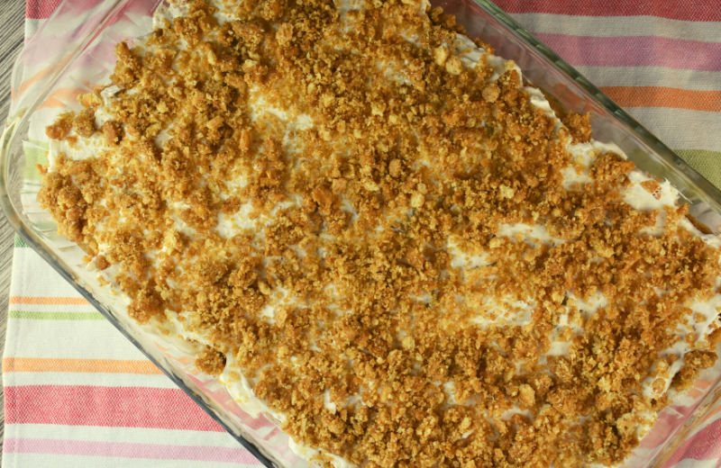 No Bake Apple Cheesecake Salad is a six layer, no bake dessert that features a list of the best dessert ingredients: peanut butter, graham crackers, apple pie filling, whipped topping, and cream cheese.  This easy fluff recipe will be a hit at your next party or get-together.