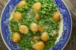 Creamed Peas and New Potatoes come together quickly on the stove-top and pair perfectly along side of any entree.  This old fashioned side dish tastes just like Mom or Grandma made it.