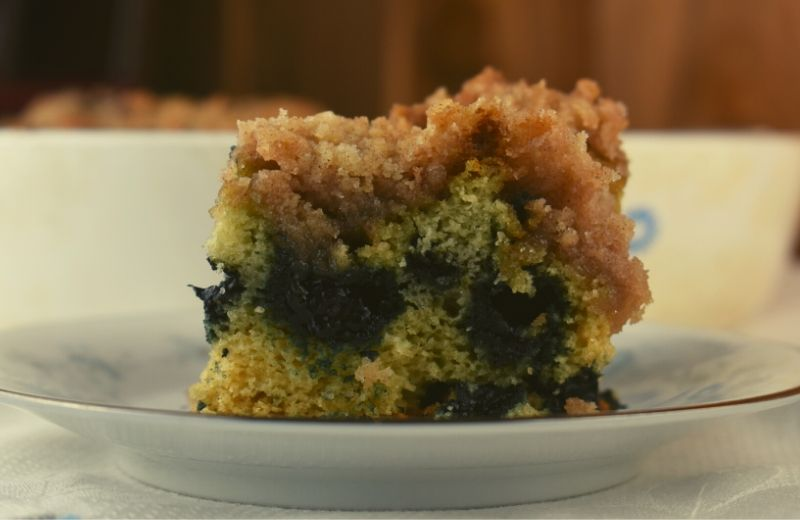 This Blueberry Coffee Cake is an old fashioned recipe that features a lightly sweetened blueberry cake with an over the top streusel topping made with butter, sugar, flour and cinnamon.