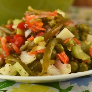 Southern Vegetable Salad is a tried and true vinegar based salad that marinates in the refrigerator.  It's cool and refreshing, and gets better with time. Store this marinated vegetable salad up to a month in the refrigerator.