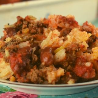 Got picky kids? I've got a new meal just for you. Hamburger Hot Dish with Rice is an easy casserole that my kids love, and yours will too. Featuring ground beef, rice, and kidney beans in a base of tomato sauce, you may already have all the ingredients on hand.