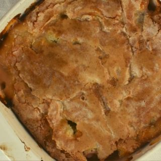 Rhubarb Batter Cake is the perfect summer dessert. This rhubarb dessert features three layers of flavor with the piece de resistance being a magic, crunchy sugar topping.
