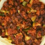 Zucchini Tomato Bacon Bake is the a new spin on zucchini casserole.  Chunks of zucchini are baked in a homemade marinara sauce and topped with crispy bacon.