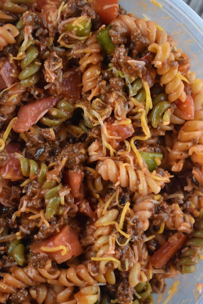 Western Dressing Pasta Salad has all your favorite taco toppings. Containing hamburger and pasta, it's hearty enough to make a full meal.