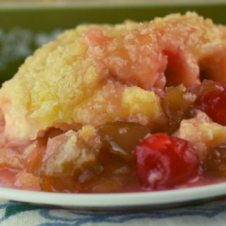 Cherry Rhubarb Crisp with sour cream is made in a 9x13 pan which serves a crowd.  Served alone or drizzle the rhubarb syrup over ice cream for an old fashioned dessert.  The addition of maraschino cherries in this rhubarb crisp makes it extra special.