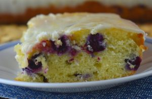 Lemon Glazed Blueberry Cake is a simple Cake Mix Blueberry Cake recipe. The result is a super moist cake packed with flavor, perfect for breakfast of dessert.