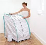 woman opening portable sauna