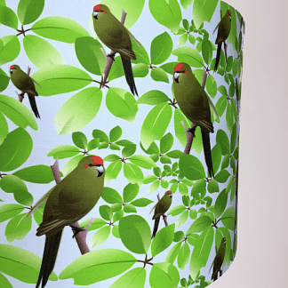 A photo showing part of a kakariki lampshade.