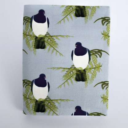 Product photograph showing the front of the visual diary. The fabric is a repeat pattern showing kereru seated in a mamaku tree fern.