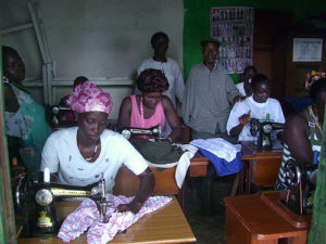 women learning to sew