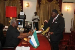 ACC_Commissioner_Presenting_Cheque_to_President_Koroma_copy1