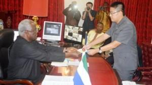 President-Koroma receives ebola donations2
