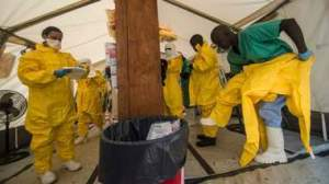 Medical staff working with Medecins sans Frontieres (MSF) put on their protective gear before entering an isolation area at the MSF Ebola treatment centre in Kailahun