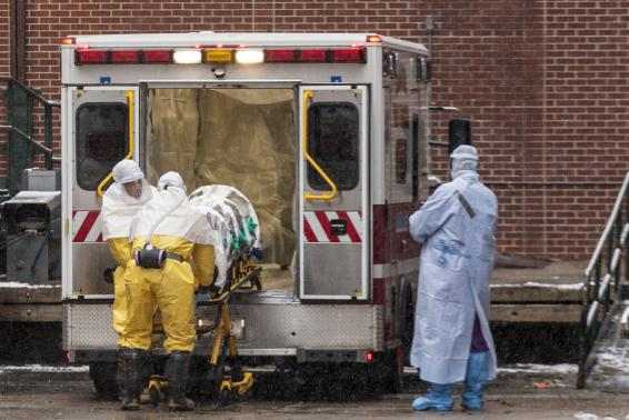 Dr. Martin Salia is placed on a stretcher upon his arrival at the Nebraska Medical Center Biocontainment Unit in Omaha