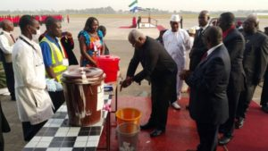 president koroma washes hands at lungi airport 2015