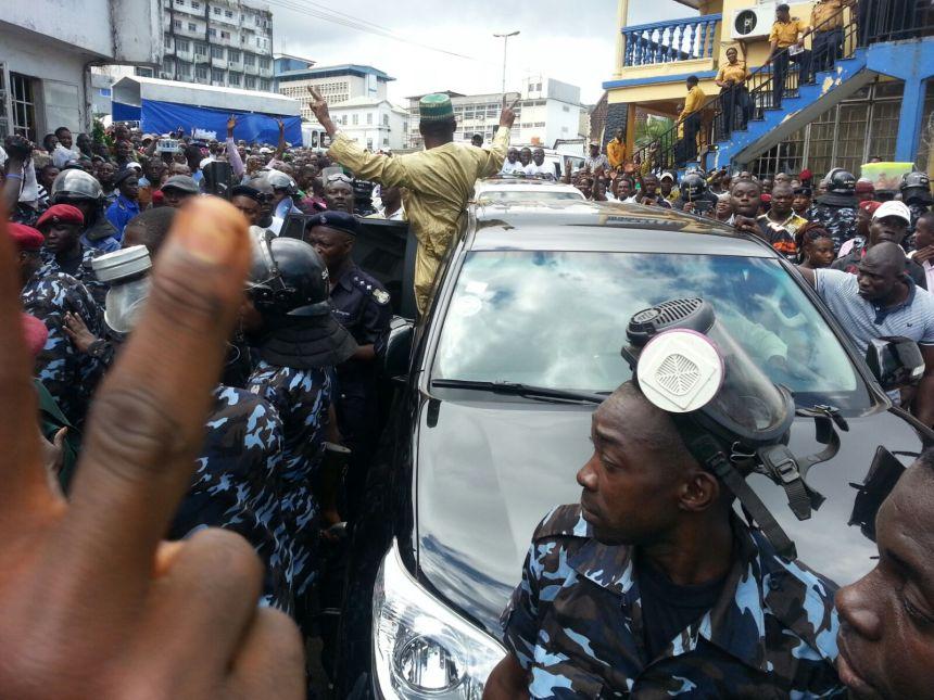 Yumkella greeting supporters in Freetown