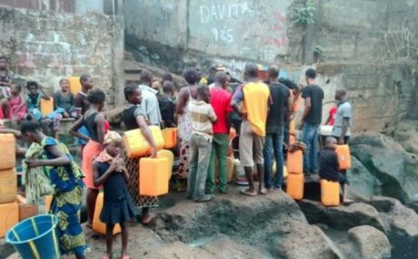 children lined up for water in Freetown April 2016