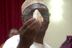 Mines Minister Minkailu Mansaray posing with sierra leones latest diamond find