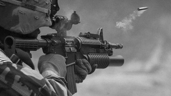 Soldier firing a round