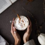 hand cupping pumpkin spice latte