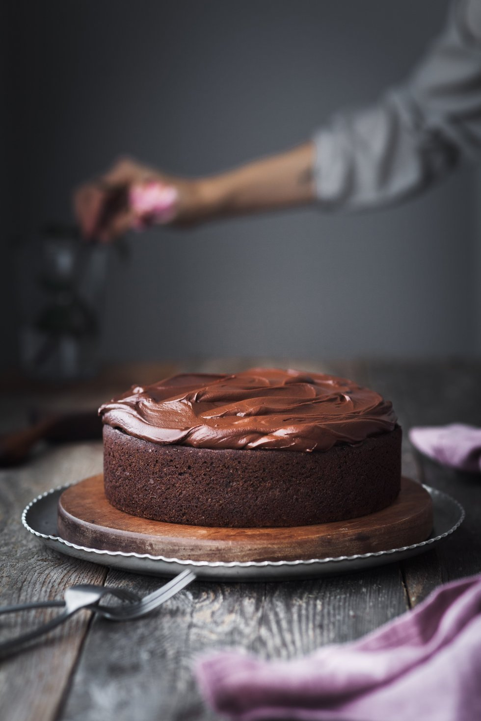 Double Chocolate Beetroot Cake with hand in background