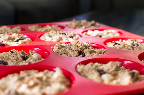 Oatmeal Banana Muffins in a muffin pan.