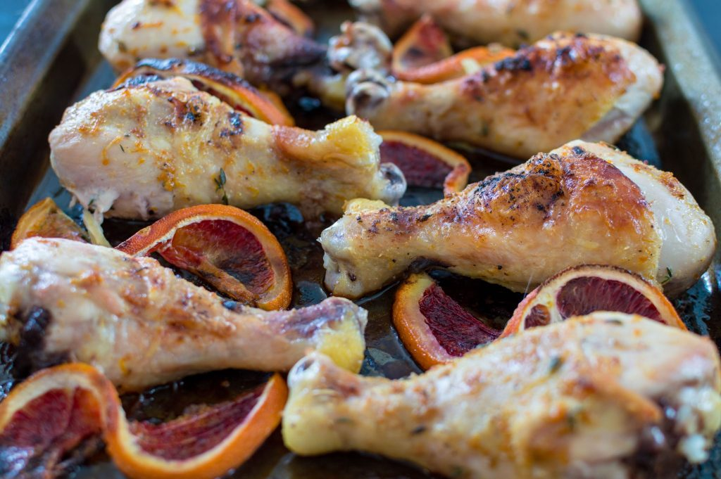 These blood orange and ginger chicken drumsticks come to together so easy, but look so stunning. This recipe is great to serve to company or for when you want a little more excitement in your week night dinner rotation. A mix of oranges ginger, and thyme gives it a zesty, tang that will leave you licking your fingers! thesimplesupper.com