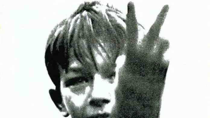 Kes (1969) Promotional poster : disaffected teen raising two fingers to the world
