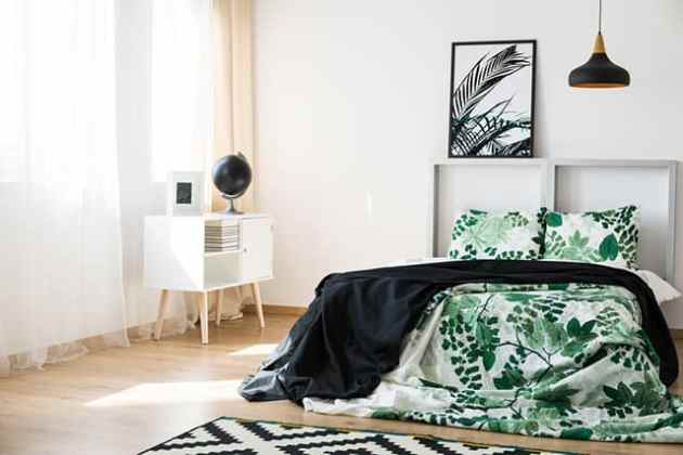 50 Of The Most Spectacular Green Bedroom Ideas   The Sleep Judge The black and green in this room is very elegant  The walls are a simple  white with some black accent pieces floating around  such as the lamps and  the