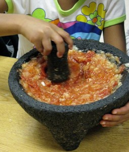 Grinding vegetables for our ndole