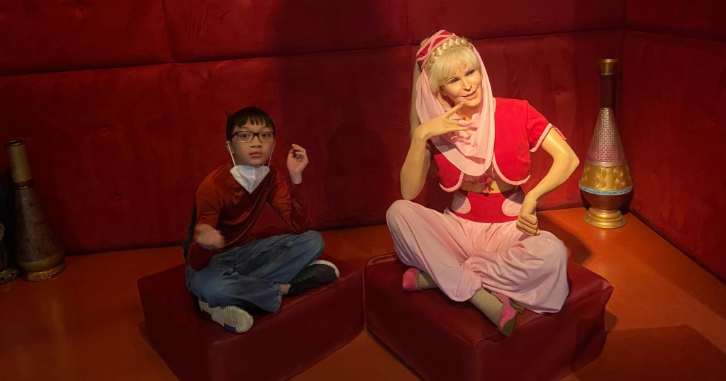 """A child poses with a wax replica from """"I Dream of Jeannie"""""""