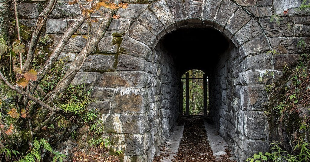 The tunnel is constructed of locally sourced stone and features an ornate archway on either side (stock photo)