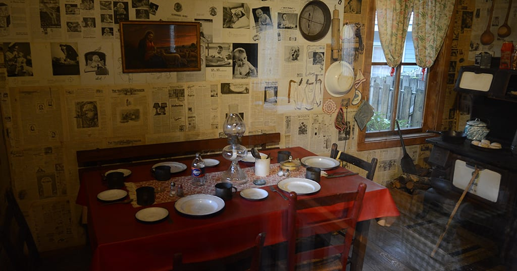 A table sits inside Dolly Parton's childhood replica home