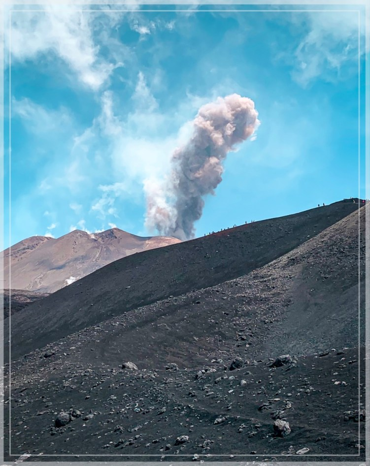 ash column rising from Mount Etna in July 2019