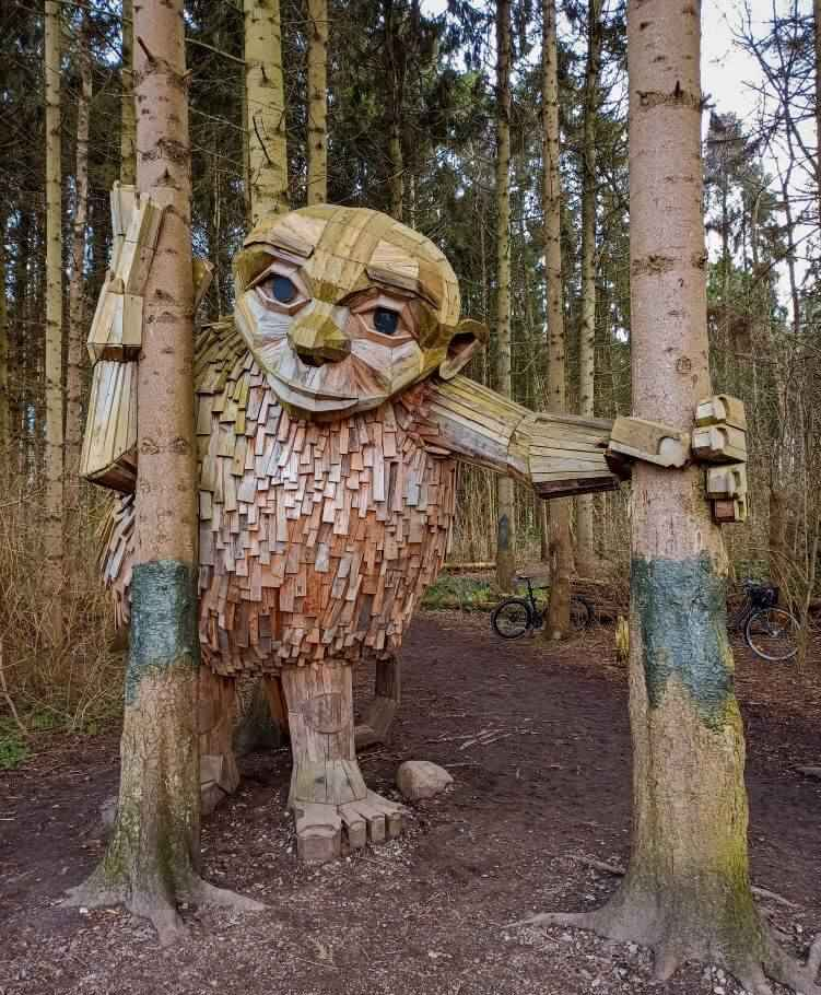 A scrap wood sculpture called Little Tilde which is also a part of the Six Forgotten Giants sculptures by Thomas Dambo