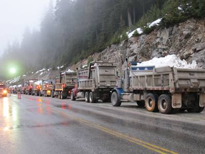 Trucks bringing snow to Cypress Mountain in B.C. for the 2010 Winter Olympics.