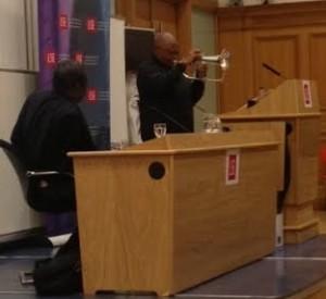 Performing Stimela as Professor Thandika Mkandawire looks on
