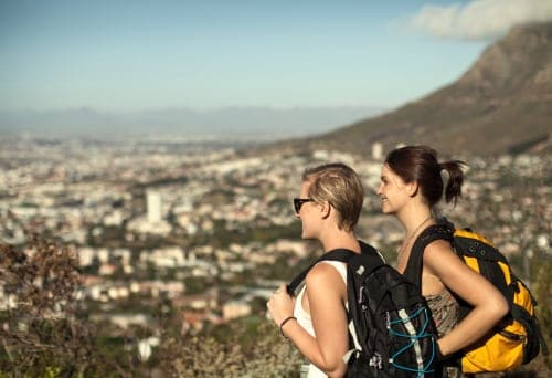 Two young women looking at view from Table Mountain, Cape Town, South Africa. Credit: Getty/Seb Oliver