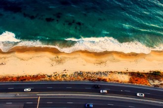 A shot of the highway and ocean near Laguna Beach, California.