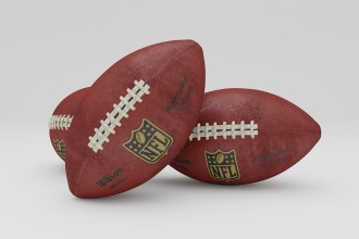 A photo of three footballs.