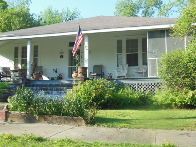 3 bed, 2 bath, unique home with 12 foot ceilings and vacant lot next door that can be purchased with the home.