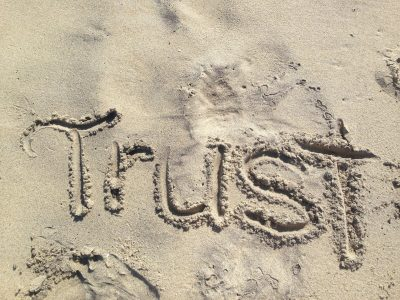 The challenge of learning to trust others